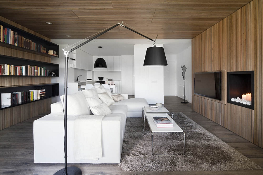 Plush white decor coupled with dark floor lamp and pendants
