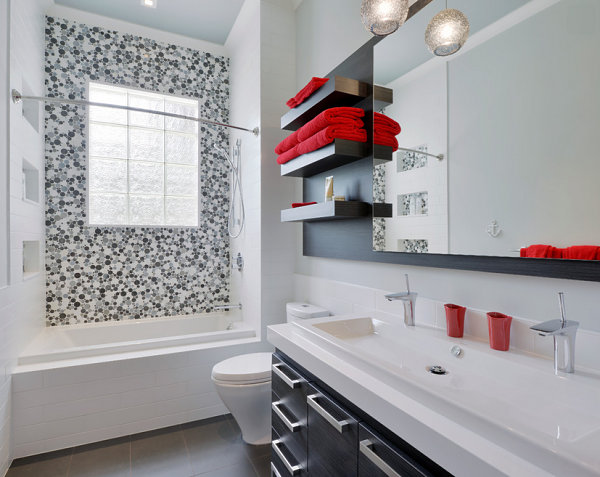 Red accents in a black and white bathroom