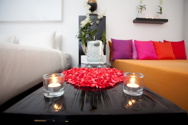 Romantic bedroom idea with candles and roses