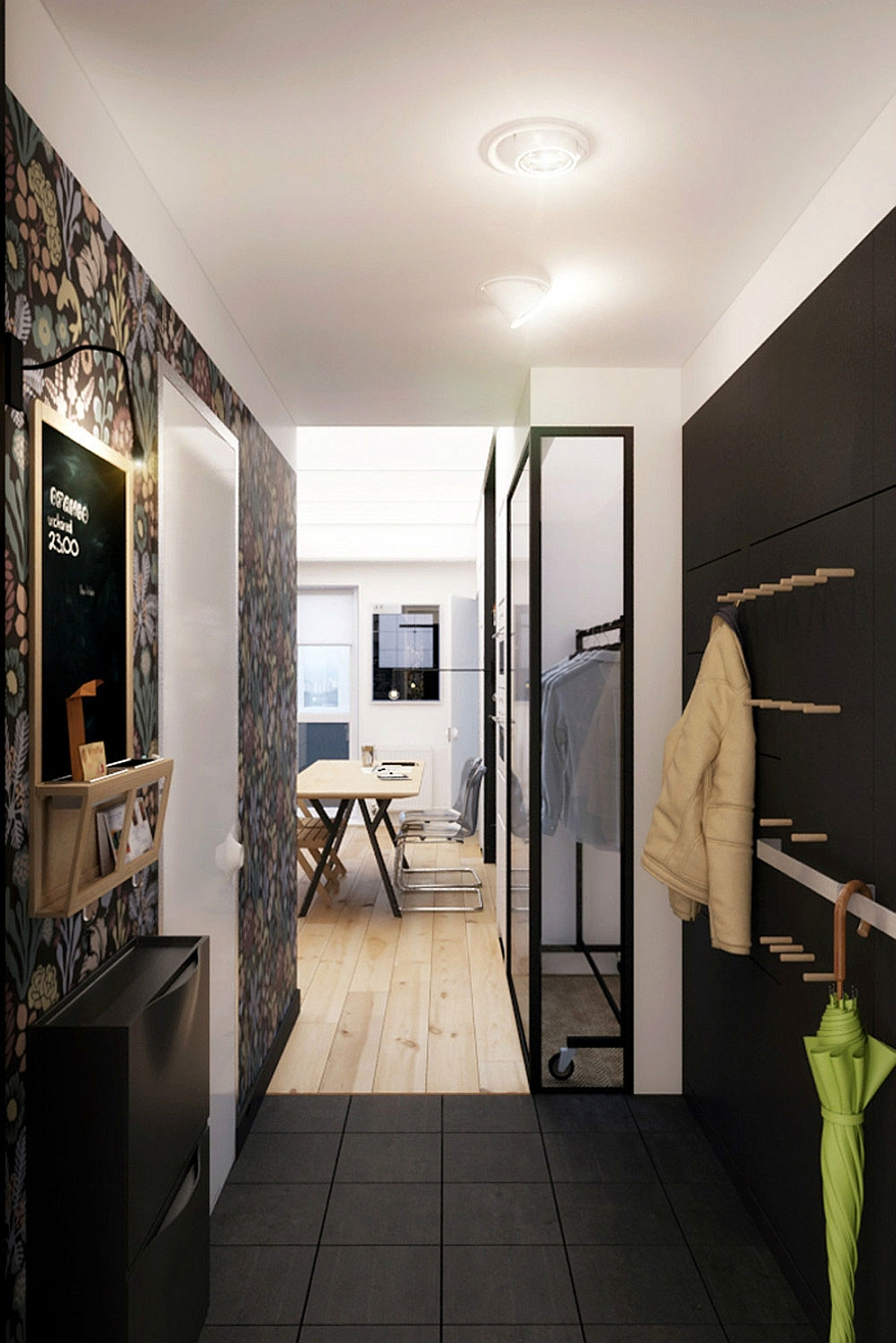 Small entryway clad in black Tiny Apartment In Black And White Charms With Space Saving Design