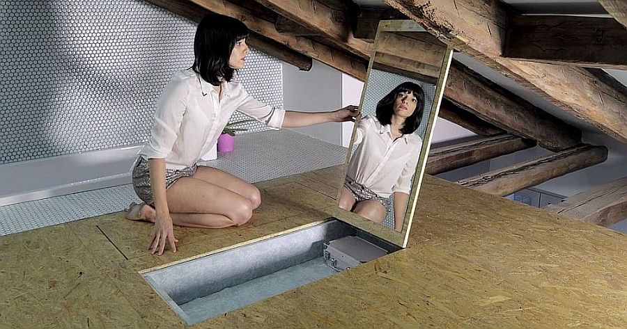 Space conscious hidden dressing mirror idea for bedroom Space Saving Modern Loft Has Everything From Secret Doors To Hidden Shelves