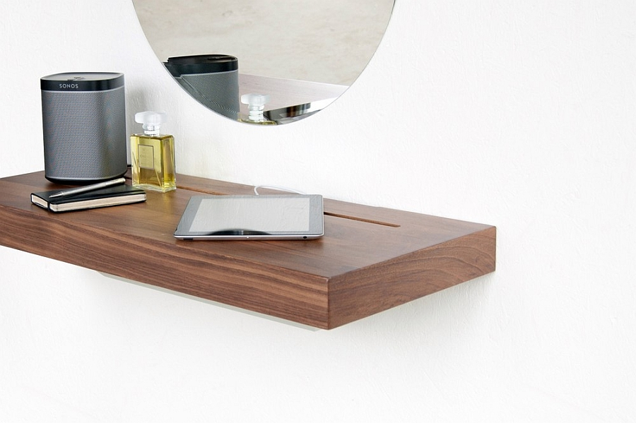Stage doubles as work desk Elegant Stage Offers A Discreet Charging Shelf For Your Smart Gadgets