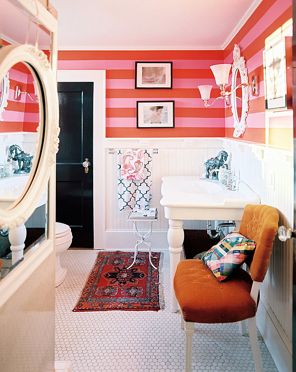 Striped walls in a colorful bathroom