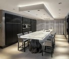 Stunning dining room and kitchen with illuminated white Onyx top