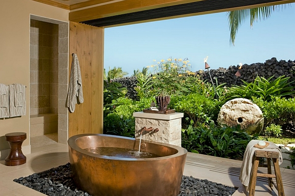 Stunning tropical ambiance combines beautifully with the copper tub on a bed of river stones