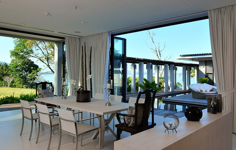 Stylish modern dining space with sea views