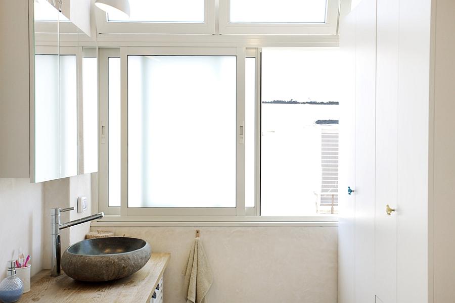 Stylish stone sink inside the bathroom
