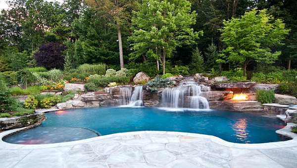 Swimming pool waterfalls that flow naturally out