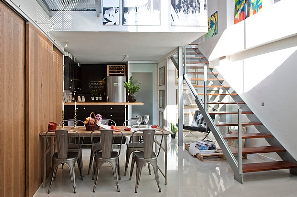 Table at the dining area seems like a natural extension of the wooden walls
