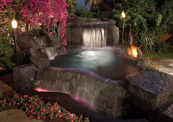 Tiki torches add to the natural ambiance of the waterfall pool