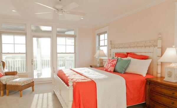 Tropical bedroom with peach and coral tones