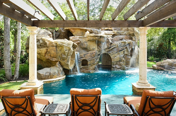 view in gallery view of the arched grotto under the waterfalls from the poolside pergola - Swimming Pools With Grottos