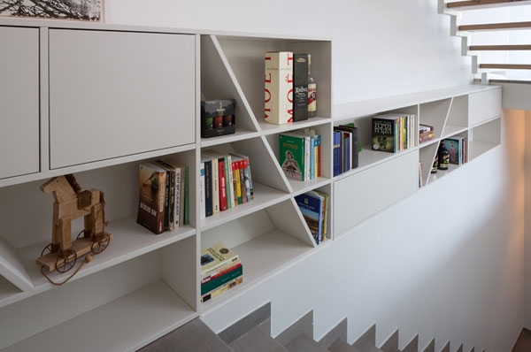 Wall-mounted bookcase next to the stairs