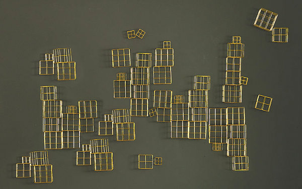 Wall sculpture made from brass cubes