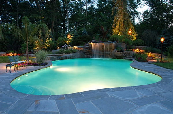 Waterfalls cascade over natural stone and into the gorgeous pool