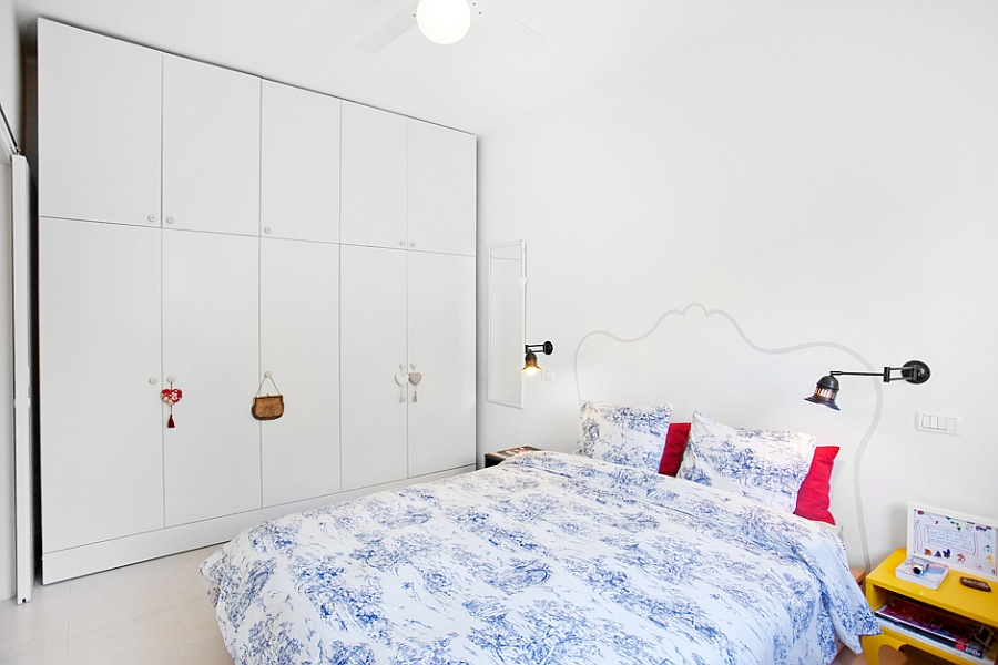 White wardrobe and shelves in the bedroom