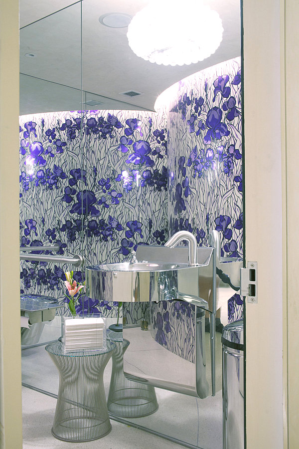 Wire table in an iris-themed bathroom