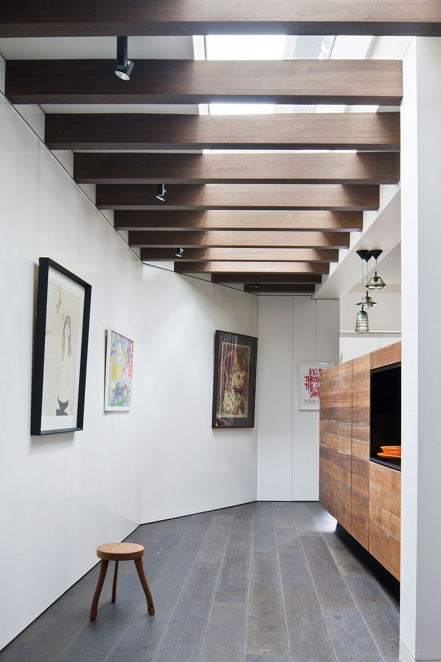 Wooden beams on the ceiling and an art gallery like setting