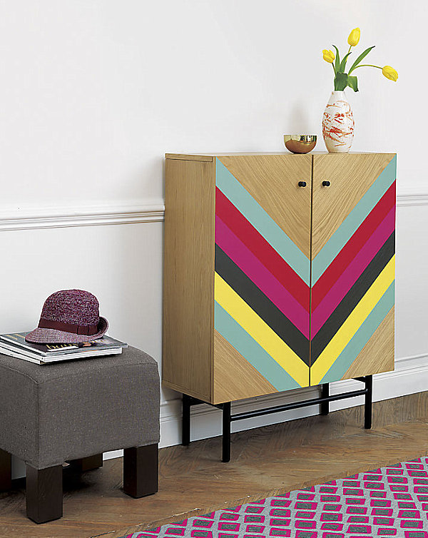 Wooden cabinet with colorful bands