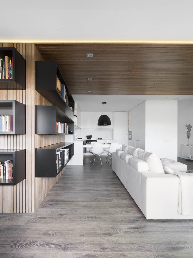 Wooden walls that house the stylish book shelves