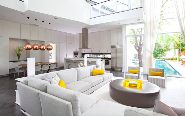 Yellow pops of color in a gray living room