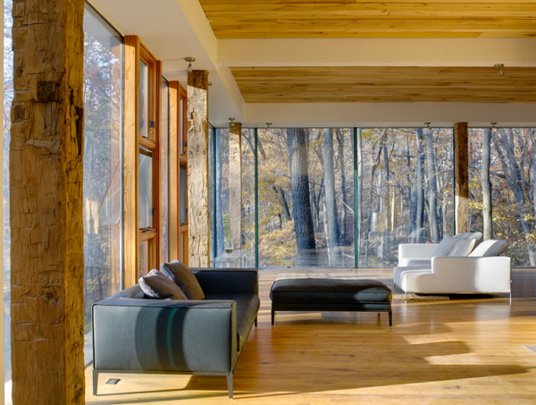 Interior of a living room with sofas and floor to ceiling windows