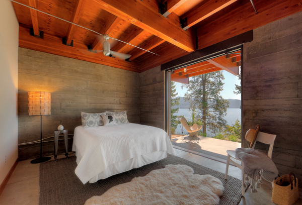 Interior of a modern rustic bedroom with wood ceilings