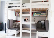 A great work area and conversation nook under the loft bunk bed!