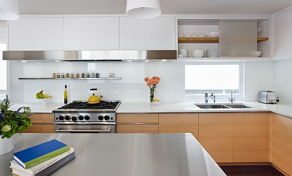 A minimalist take on white kitchen cabinets along with wooden ones