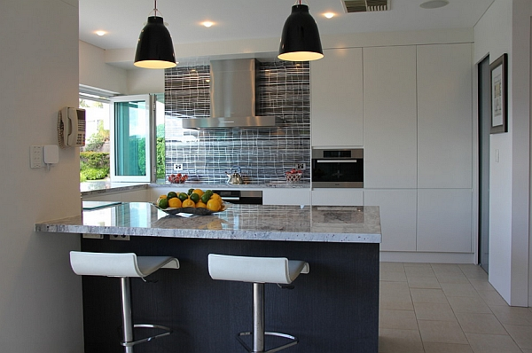 Beautiful kitchen and serving area with Caravaggio pendants above