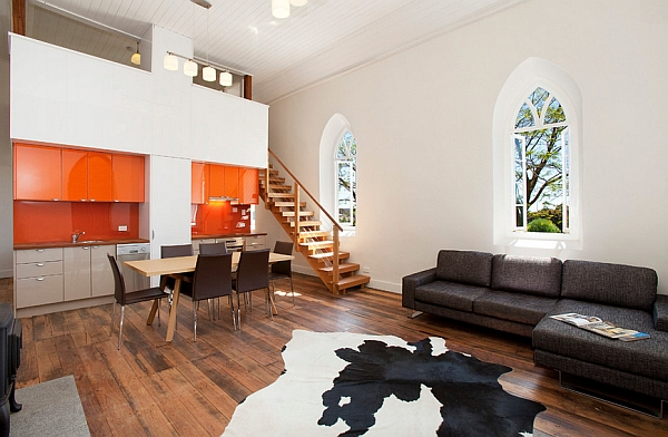 Bold dash of color to the open floor plan with the orange cabinets
