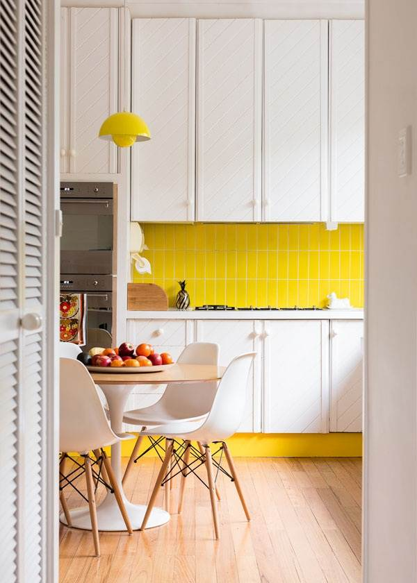 Bright yellow details in a crisp kitchen