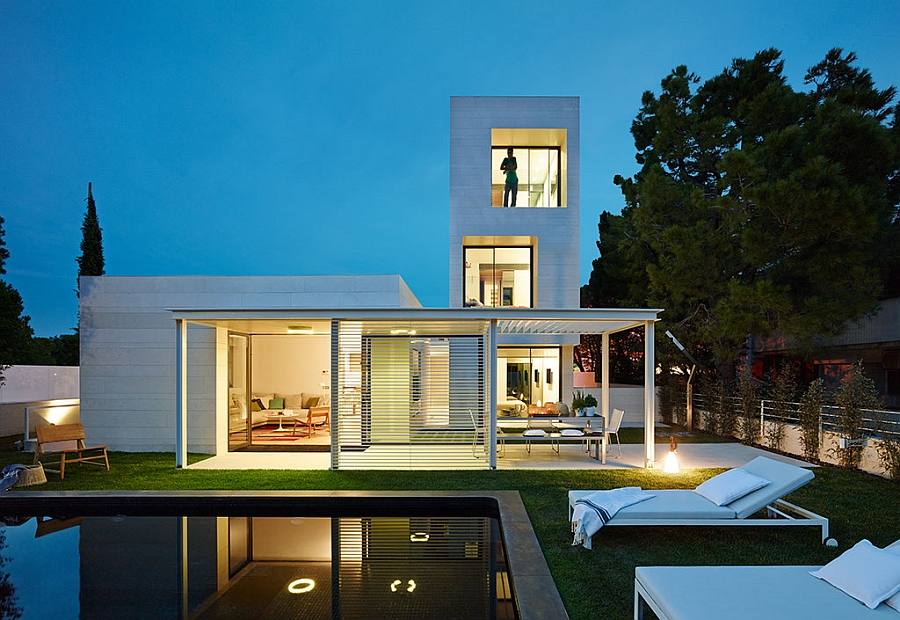 Cool backyard of minimalist home in white