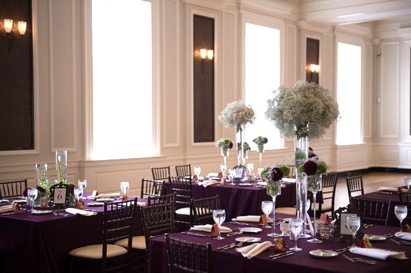 Deep purple tablecloths at a contemporary wedding