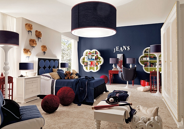 Gorgeous dark blue accent wall enlivens the room