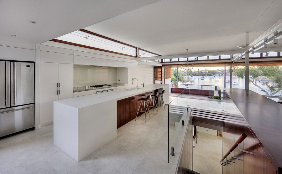 Gorgeous modern kitchen with large island in white