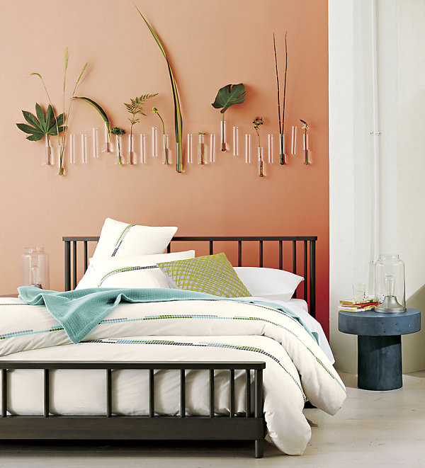 Green accents in a peach bedroom