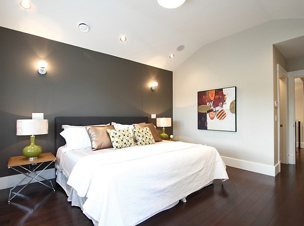 Grey accent wall in a white bedroom