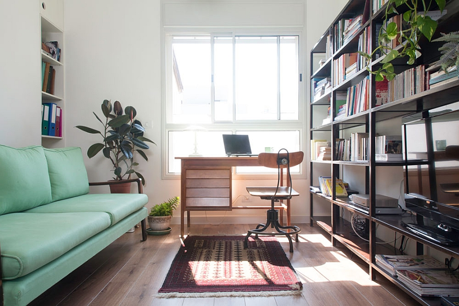 Home office coupled with the entertainment unit Ingenious Apartment In Tel Aviv Adopts A Trendy Vintage Style!