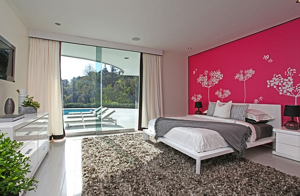 Hot pink and lovely decal work give the bedroom a cool personality