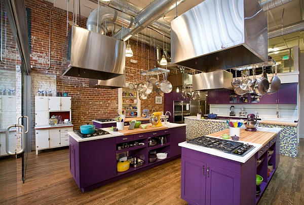 Industrial style kitchen with bold purple cabinets