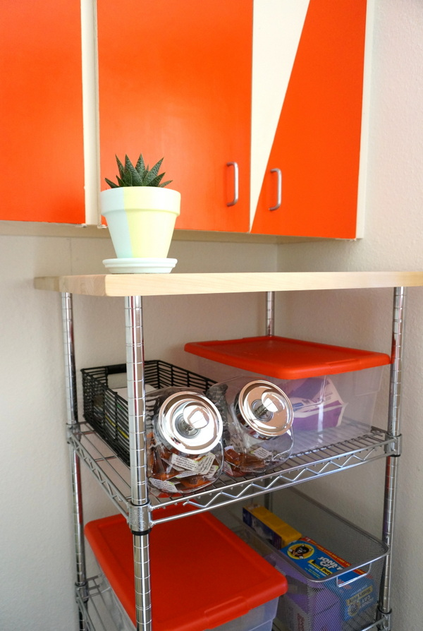 Industrial-style shelving in a modern laundry room