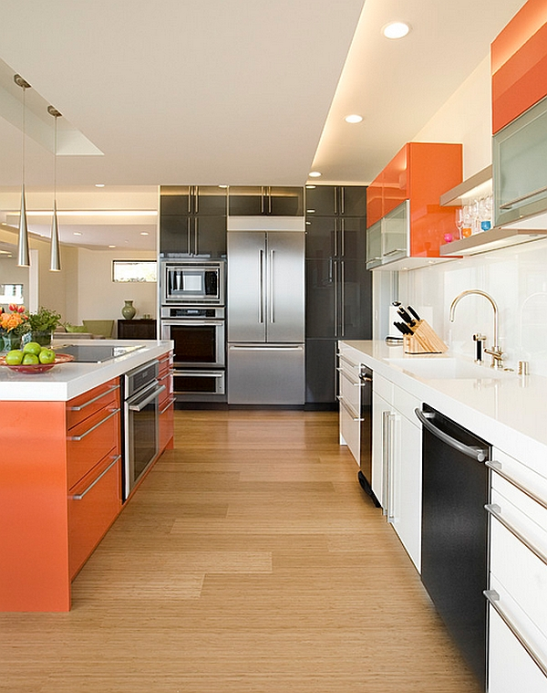 Kitchen cabinet color scheme that brings together orange, white and black