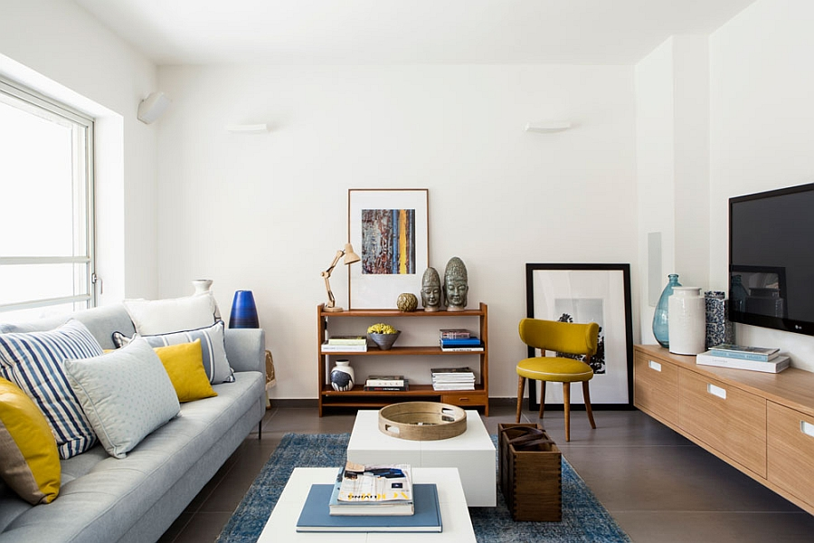 Living room with bold yellow and blue accents