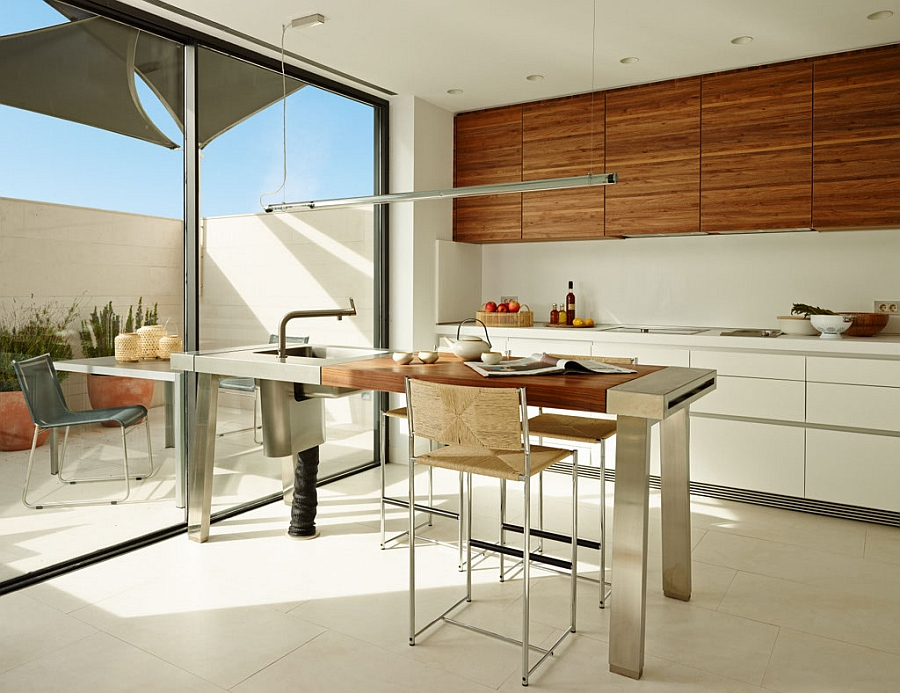 Lovely dining area in white with wooden table