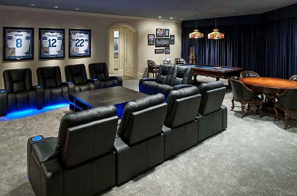 Luxurious media room with framed sports jerseys