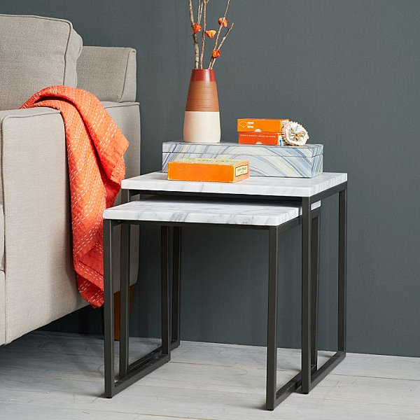 Orange accents in a charcoal room