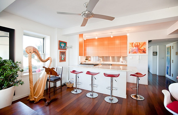 Orange kitchen cabinets in a white backdrop