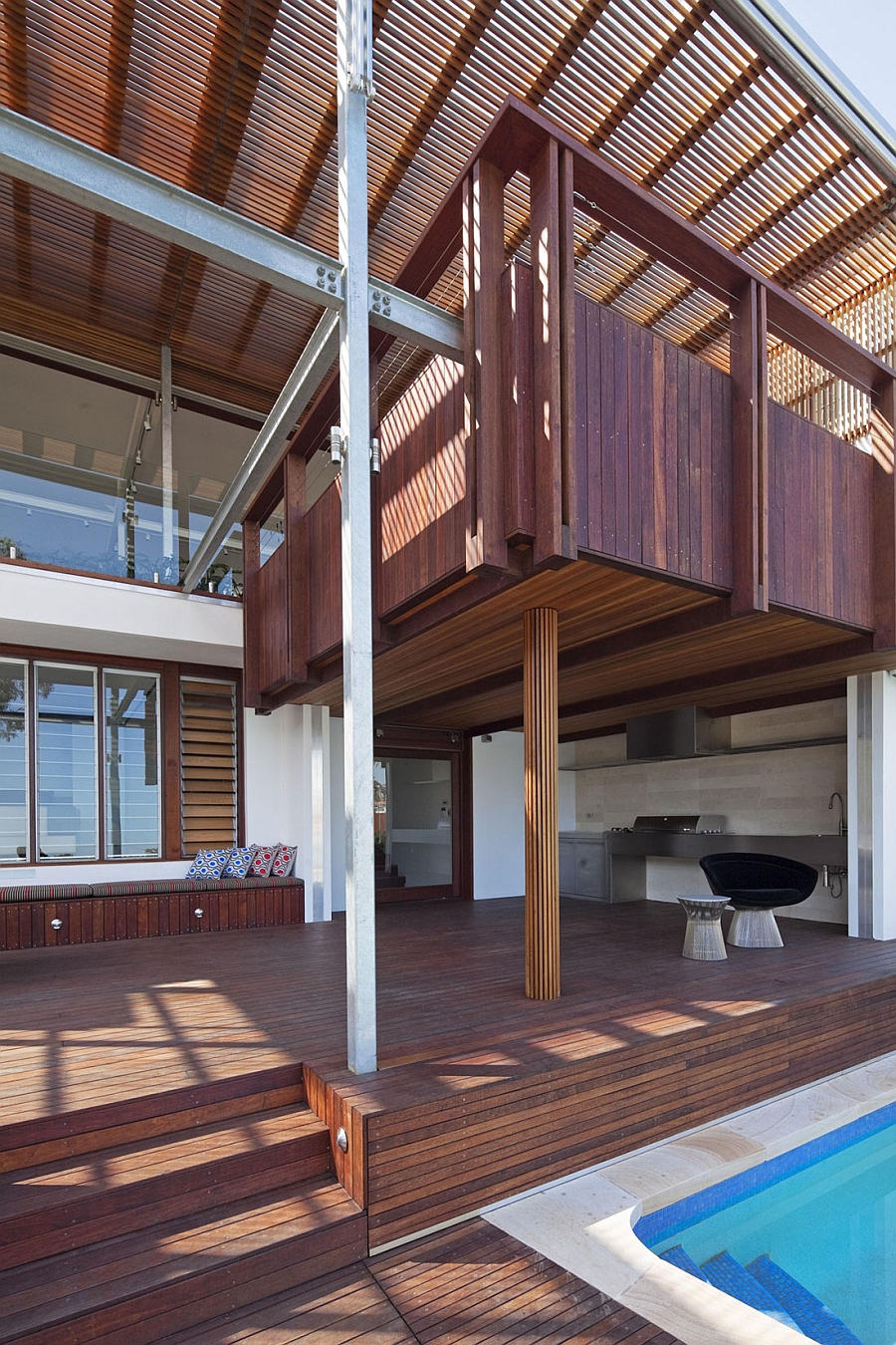Outdoor living spaces and barbeque area Gorgeous Multi Level Family House In Sydney Charms With Its Use Of Wood