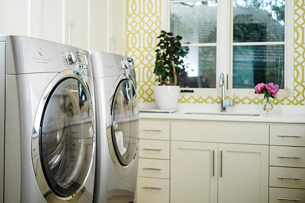 Plant and floral touches in an organized laundry room